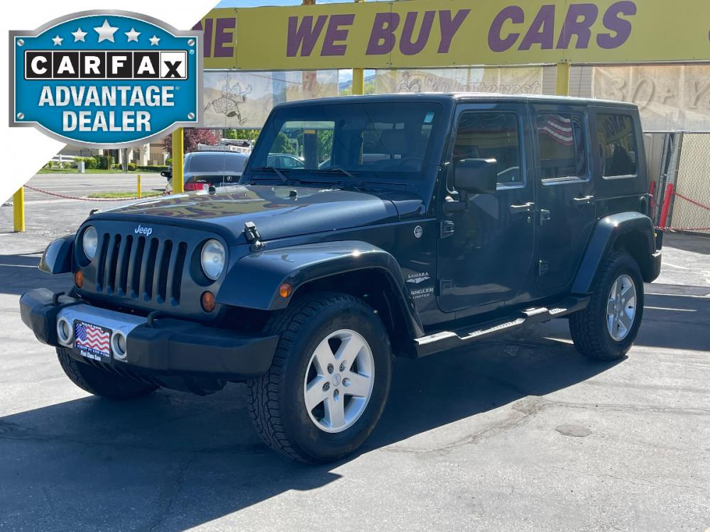 2008 Steel Blue Metallic /Gray Cloth Jeep Wrangler Unlimited Sahara 4WD (1J4GA591X8L) with an 3.8L V6 engine, Automatic transmission, located at 801 South State Street, Salt Lake City, UT, 84111, (801) 328-0098, 40.751953, -111.888206 - Photo #0