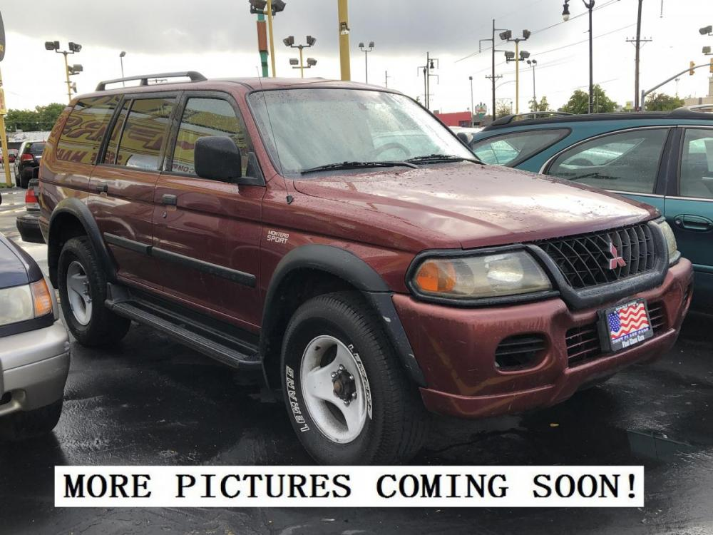 2001 Cambridge Red Pearl /Tan Cloth Mitsubishi Montero Sport ES 4WD (JA4MT21H31P) with an 3.0L V6 engine, Automatic transmission, located at 801 South State Street, Salt Lake City, UT, 84111, (801) 328-0098, 40.751953, -111.888206 - Photo #0